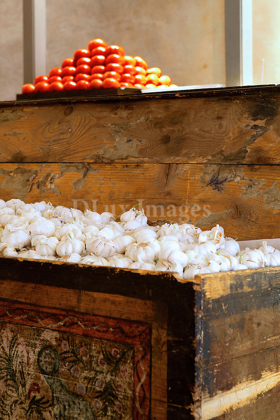 rustic wood chest filled with garlic<br />  Milos Restaurant New York City