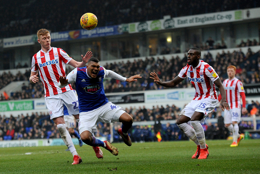 Ipswich Town's Collin Quaner battles with Stoke City's Bruno Martins Indi and  Sam Clucas<br /> <br /> Photographer Hannah Fountain/CameraSport<br /> <br /> The EFL Sky Bet Championship - Ipswich Town v Stoke City - Saturday 16th February 2019 - Portman Road - Ipswich<br /> <br /> World Copyright © 2019 CameraSport. All rights reserved. 43 Linden Ave. Countesthorpe. Leicester. England. LE8 5PG - Tel: +44 (0) 116 277 4147 - admin@camerasport.com - www.camerasport.com