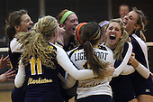 The Clarkston Wolves volleyball team celebrates after defeating Canton in 2-A quarterfinal action at Fenton Tuesday, Nov. 15, 2011.
