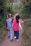 Two young girls walking down trail, Rocky Mtns, CO