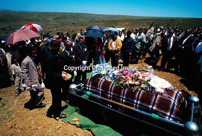 dicuinit0036 Culture Initiation A funeral for a Xhosa boy who died during the manhood ceremony. Every year boys die because the wounds during the circumsision gets infected. They are supposed to heal in the bush, only with traditional medicine. Most boys rather suffer or die than go to a hospital. Every year many boys end up in hospitals and get their organs severely damaged. Some boys even commit suicide when they found out that they can't have a normal life..©Per-Anders Pettersson/iAfrika Photos