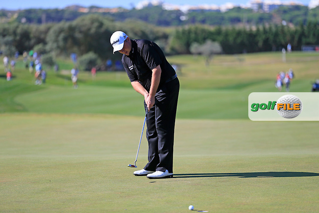 Shane Lowry (IRL) takes his putt on the 2nd green during Thursday's Round 1 of the 2013 Portugal Masters held at the Oceanico Victoria Golf Club. 10th October 2013.<br /> Picture: Eoin Clarke www.golffile.ie