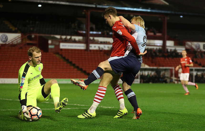 Blackpool's Mark Cullen fights for the ball against Barnsley's Angus MacDonald as Barnsley's Adam Davies scoops the ball<br /> <br /> Photographer Rachel Holborn/CameraSport<br /> <br /> Emirates FA Cup Third Round Replay - Barnsley v Blackpool - Tuesday 17th January 2017 - Oakwell Stadium - Barnsley<br />  <br /> World Copyright &copy; 2017 CameraSport. All rights reserved. 43 Linden Ave. Countesthorpe. Leicester. England. LE8 5PG - Tel: +44 (0) 116 277 4147 - admin@camerasport.com - www.camerasport.com
