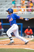 Luis Carpio (11) of the Kingsport Mets follows through on his swing against the Greeneville Astros at Hunter Wright Stadium on July 7, 2015 in Kingsport, Tennessee.  The Mets defeated the Astros 6-4. (Brian Westerholt/Four Seam Images)