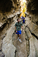 Hikers explore Neat Coulee along the White Cliffs of the Missouri River in central Montana.