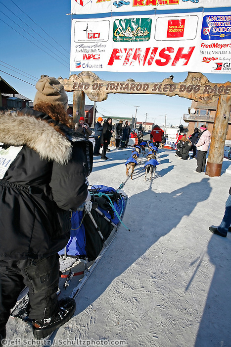 Friday March 16, 2007  - Nome, Alaska ----  Rick Casillo mushes his dogs under the burl arch finish line in Nome