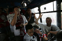 United States fans who had taken public transit to the game cheer and chant after they are  placed on a Mexican police transport bus after they leave Azteca Stadium under a police escort. Mexican police officers in riot gear separated the team's fan supporters to prevent any violence and fearing for the fan's safety, Mexican police transported the United States fans to a different subway stop to travel back to their hotels. The United States Men's National Team played Mexico in a CONCACAF World Cup Qualifier match at Azteca Stadium in, Mexico City, Mexico on Wednesday, August 12, 2009.