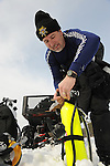 Lt. James Woods of the Oneida County Sheriff's Department checks a spare air tank prior to an ice dive on Big Carr Lake, Lake Tomahawk, Wis. The smaller air tank is used if there is a malfunction or the diver runs out of air on the main air tank.
