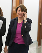 United States Senator Amy Klobuchar (Democrat of Minnesota) speaks on a cell phone as she walks in the hallway during a break in the testimony of Dr. Christine Blasey Ford  before the US Senate Committee on the Judiciary on the nomination of Judge Brett Kavanaugh to be Associate Justice of the US Supreme Court to replace the retiring Justice Anthony Kennedy on Capitol Hill in Washington, DC on Thursday, September 27, 2018.   <br /> Credit: Ron Sachs / CNP<br /> (RESTRICTION: NO New York or New Jersey Newspapers or newspapers within a 75 mile radius of New York City)