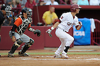 Left fielder Gene Cone (19) of the South Carolina Gamecocks hits in an NCAA Division I Baseball Regional Tournament game against the Campbell Camels on Friday, May 30, 2014, at Carolina Stadium in Columbia, South Carolina. The catcher is Campbell's Steven Leonard (6). South Carolina won, 5-2. (Tom Priddy/Four Seam Images)
