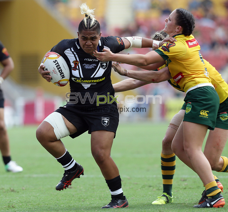 New Zealand's Ngatokotoru Arakua, left, is stopped by Australia's Brittany Breayley, right, during the women's Rugby League World Cup final between Australia and New Zealand, Suncorp Stadium, Brisbane, Australia, 2 December 2017. Copyright Image: Tertius Pickard / www.photosport.nz MANDATORY CREDIT/BYLINE : Tertius Pickard/SWpix.com/PhotosportNZ