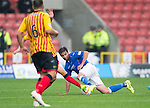 Partick Thistle v St Johnstone....25.10.14   SPFL<br /> Simon Lappin battles with Stuart Bannigan<br /> Picture by Graeme Hart.<br /> Copyright Perthshire Picture Agency<br /> Tel: 01738 623350  Mobile: 07990 594431