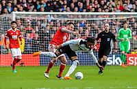 Nottingham Forest's forward Lee Tomlin (15) pushes Derby County's midfielder Kasey Palmer (7) to the ground during the Sky Bet Championship match between Nottingham Forest and Derby County at the City Ground, Nottingham, England on 10 March 2018. Photo by Stephen Buckley / PRiME Media Images.
