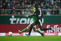 FUSSBALL   1. BUNDESLIGA   SAISON 2012/2013    22. SPIELTAG SV Werder Bremen - SC Freiburg                                16.02.2013 Nils Petersen (li, SV Werder Bremen) erzielt das Tor zum 1:1. Fallou Diagne (re, SC Freiburg) kommt zu spaet