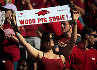 NWA Democrat-Gazette/CHARLIE KAIJO An Arkansas Razorbacks fan holds up a banner during the second quarter of a football game, Saturday, September 15, 2018 at Donald W. Reynolds Razorback Stadium in Fayetteville.