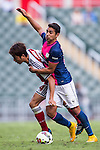 Yuto Nakamura of SCAA (L) competes for the ball with Matthew Tomas Lam of Kitchee (R) during the HKFA Premier League between South China Athletic Association vs Kitchee at the Hong Kong Stadium on 23 November 2014 in Hong Kong, China. Photo by Aitor Alcalde / Power Sport Images