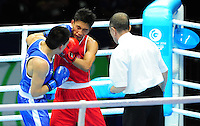 New Zealand's Chad Milnes (blue) defeats Bangladesh's Sura Chakma (red) in the men's light (62kg) round of 32<br /> <br /> Photographer Chris Vaughan/CameraSport<br /> <br /> 20th Commonwealth Games - Day 3 - Saturday 26th July 2014 - Boxing - SECC - Glasgow - UK<br /> <br /> © CameraSport - 43 Linden Ave. Countesthorpe. Leicester. England. LE8 5PG - Tel: +44 (0) 116 277 4147 - admin@camerasport.com - www.camerasport.com