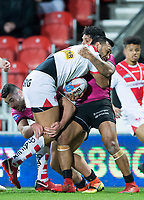 Picture by Allan McKenzie/SWpix.com - 06/04/2018 - Rugby League - Betfred Super League - St Helens v Hull FC - The Totally Wicked Stadium, Langtree Park, St Helens, England - St Helens's Dominique Peyroux is tackled by Hull FC's Jake Connor and Albert Kelly.