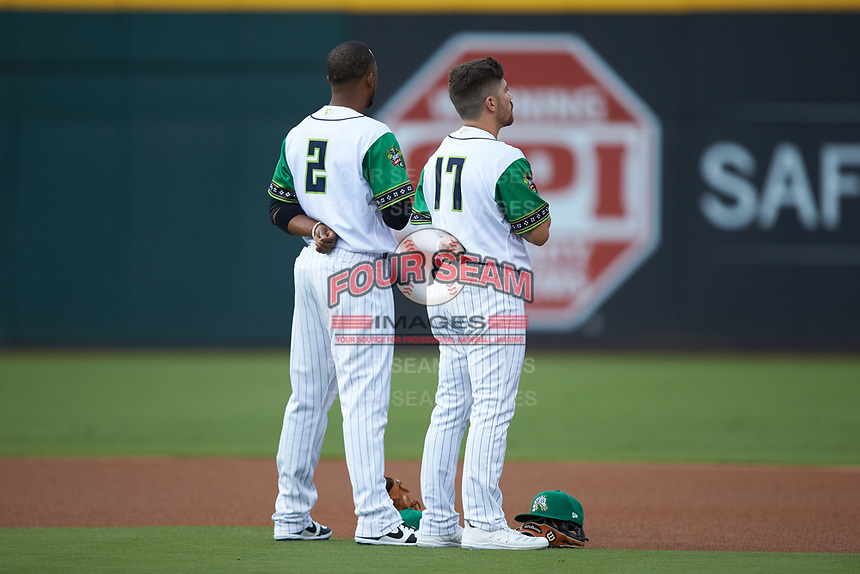 (L-R) Caballeros de Charlotte infielders Alcides Escobar (2) and Danny Mendick (17) stand for the National Anthem prior to the game against the Buffalo Bisons at BB&T BallPark on July 23, 2019 in Charlotte, North Carolina. The Bisons defeated the Caballeros 8-1. (Brian Westerholt/Four Seam Images)