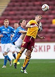 Motherwell v St Johnstone...30.08.14  SPFL<br /> Keith Lasley feels the boot of Gary McDonald<br /> Picture by Graeme Hart.<br /> Copyright Perthshire Picture Agency<br /> Tel: 01738 623350  Mobile: 07990 594431