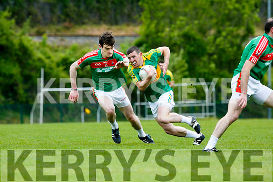 In Action S. Kerry Niall O'Shea gets away from  Kilcummin's Donal Maher at the  Garveys Supervalu Senior County Football Championship Round 2B Kilcummin V South Kerry at Dr Crokes Lewis Road Killarney on Sunday