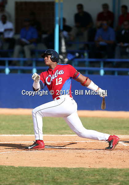 Hector Olivera works out at the Dominican Republic air force base in front of 100+ Major League Baseball scouts prior to being declared eligible to sign since defecting from his native Cuba in Santo Domingo, Dominican Republic on February 11, 2015 (Bill Mitchell)