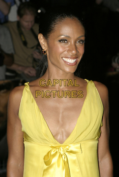 JADA PINKETT SMITH.Collateral UK premiere, UCI Empire, Leicester Square, London, 2nd September 2004..half length long yellow satin dress ribbon bow.Ref: AH.www.capitalpictures.com.sales@capitalpictures.com.©Capital Pictures.