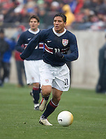 Brian Ching dribbles upfield at Pizza Hut Park in Frisco, Texas, Sunday, Feb. 19, 2005.  USA won 4-0.