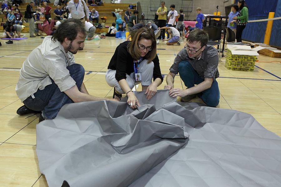 The oversized folding event. Team The Grid Monkeys fold an origami tessellation Sternutation designed by Ben Parker. Team members: Ray Schamp, Beth Johnson, Tom Crain, Ben Parker
