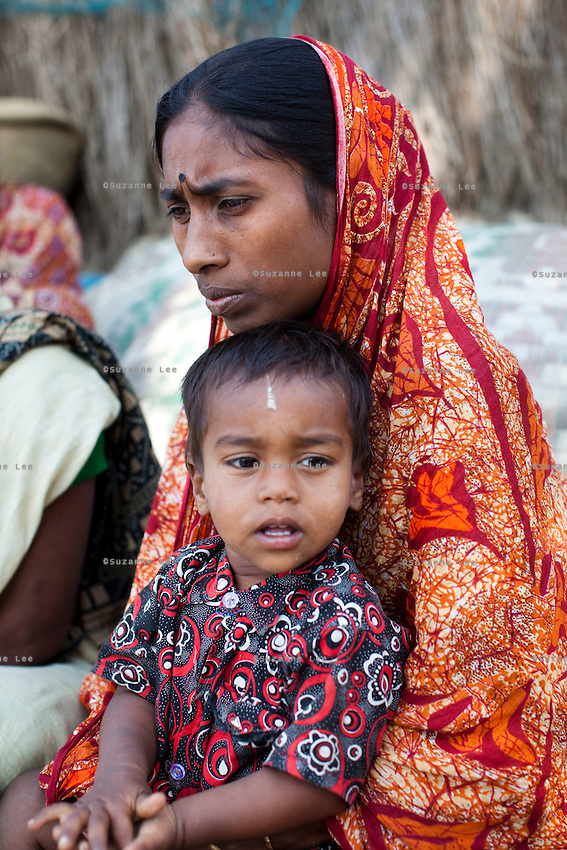 Widow Mamata Mandol, 26, speaks of her husband's recent death as she sits with other widows near her home on Gosaba island, Sundarban, West Bengal, India, on 18th January, 2012. While her husband was killed while fishing, tigers have been known to swim, sometimes underwater, to the village to hunt humans. A successful Royal Bengal tiger breeding program has increased their numbers but decreased the number of husbands. There are now an estimated 3,000 widows in the villages where their husbands, have been killed by tigers. Photo by Suzanne Lee for The National (online byline: Photo by Szu for The National)