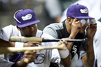 Winston-Salem Dash pitcher Luis Martinez (right) and teammate Luis Alexander Basabe (16) have some fun in the dugout during the game against the Lynchburg Hillcats at BB&T Ballpark on May 1, 2018 in Winston-Salem, North Carolina.  The Dash defeated the Hillcats 9-0. (Brian Westerholt/Four Seam Images)