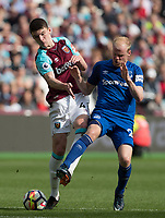 Davy Klaassen of Everton blocks a Declan Rice of West Ham shot at goal during the Premier League match between West Ham United and Everton at the Olympic Park, London, England on 13 May 2018. Photo by Andy Rowland / PRiME Media Images.