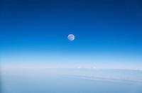 Full moon in a blue sky.