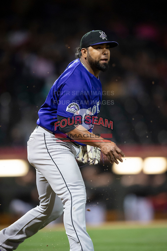 Albuquerque Isotopes relief pitcher Jairo Diaz (18) underhands a ball to first base during a Pacific Coast League game against the El Paso Chihuahuas at Southwest University Park on May 10, 2019 in El Paso, Texas. Albuquerque defeated El Paso 2-1. (Zachary Lucy/Four Seam Images)