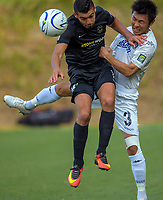 Mario Barcia (Team Wellington) and Takuya Iwata (Auckland, 9) compete for a header during the Oceania Football Championship final (second leg) football match between Team Wellington and Auckland City FC at David Farrington Park in Wellington, New Zealand on Sunday, 7 May 2017. Photo: Dave Lintott / lintottphoto.co.nz