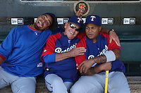 SAN FRANCISCO - JUNE 20:  Nelson Cruz, Coach Jackie Moore and Andruw Jones of the Texas Rangers sit in the dugout before the game against the San Francisco Giants at AT&T Park in San Francisco, California on Saturday, June 20, 2009.  The Giants defeated the Rangers 2-1.  Photo by Brad Mangin
