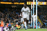 Bafetibis Gomis celebrates scoring his sides first goal  during the Barclays Premier League Match between Manchester City and Swansea City played at the Etihad Stadium, Manchester on 12th December 2015