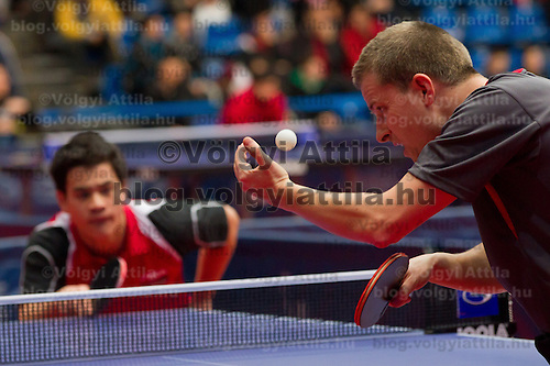 Denmark's Finn Tugwell (R) plays against .Norway's Pal Aaras (L) during the qualifier of the ITTF World Tour Hungarian Open in Budapest, Hungary on January 17, 2012. ATTILA VOLGYI