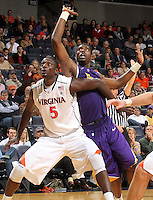 Jan. 2, 2011; Charlottesville, VA, USA; Virginia Cavaliers center Assane Sene (5) fights for a rebound with LSU Tigers forward Malcolm White (5) during the game at the John Paul Jones Arena. Mandatory Credit: Andrew Shurtleff-