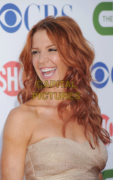 Poppy Montgomery.CBS, CW and Showtime Summer 2011 TCA Party held at The Pagoda, Beverly Hills, California, USA..August 3rd, 2011.headshot portrait beige gold strapless smiling mouth open.CAP/ROT/TM.©Tony Michaels/Roth Stock/Capital Pictures