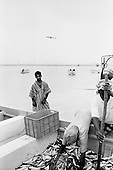 Salalah, Oman.July 2001..Fishermen bring in their daily catch.