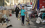 "A picture taken on April 26, 2018 show an Egyptian boy carries traditional lanterns known in Arabic as ""Fanous"", ahead of the holy Muslim month of Ramadan in Cairo, Egypt. Ramadan is sacred to Muslims because it is during that month that tradition says the Koran was revealed to the Prophet Mohammed. The fast is one of the five main religious obligations under Islam. Muslims around the world will mark the month, during which believers abstain from eating, drinking, smoking and having sex from dawn until sunset. Photo by Amr Sayed"