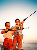 TURKEY, Istanbul, boys play with their guns by the Sea of Marmara, near the Blue Mosque on Kennedy Street