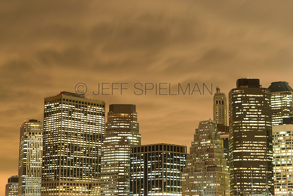 Available for Commercial and Editorial Licensing Exclusively from Getty Images<br /> <br /> Please go to www.gettyimages.com and search for image # 84067673<br /> <br /> Lower Manhattan Financial District Skyline and Overcast, Cloudy Sky at Dusk, New York City, New York State, USA
