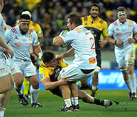 Ricky Riccitelli tackles Nathan Harris during the Super Rugby semifinal match between the Hurricanes and Chiefs at Westpac Stadium, Wellington, New Zealand on Saturday, 30 July 2016. Photo: Dave Lintott / lintottphoto.co.nz