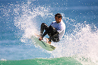 Dylan Longbottom (AUS)..Cottesloe Beach, Perth, Western Australia, Saturday August 18 2001..A round of  The Quiksilver Airshow International Series, with $20,000 in prize-money was run today at Cottesloe Beach. The Quiksilver Airshow is the richest and most spectacular surfing event to be staged at a Perth Beach. The contest is based around the futuristic moves of aerial surfing, where each surfer  is judged on their best two aerial manoeuvres in each heat. (Photo: joliphotos.com)