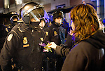 Demonstration to protest against  eviction in the morning by the police of the Hotel Madrid wich was occupied on 15 October for housing families evicted because the mortgage..A young woman offers flowers to the police. Madrid on 12/5/2011