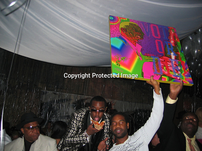 Sean P. Diddy Combs receives a gift from PM owner Unick, a painting of himself from Artist Jeffery Dread of Photovibe Gallery<br />