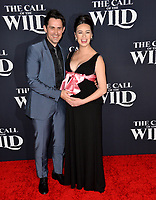 "LOS ANGELES, CA: 13, 2020: Richard de Klerk & Cara Gee at the world premiere of ""The Call of the Wild"" at the El Capitan Theatre.<br /> Picture: Paul Smith/Featureflash"