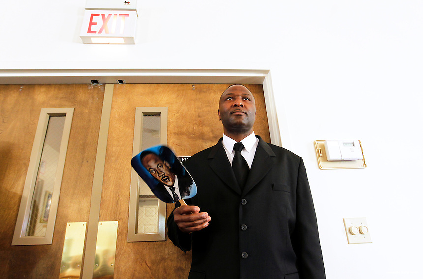 Usher Rosario McWhorter, from the Portsmouth Naval Base, stands at the door during the Martin Luther King celebration held at the New Hope Church in Portsmouth, N.H. Sunday, Jan. 16,  2011.  (Portsmouth Herald Photo Cheryl Senter)